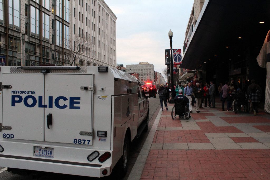 Emergency vehicles sit on a blocked-off street next to the Verizon Center in Washington, D.C., on March 25, 2015. Crowds flocked to the Verizon Center that night for a game in which the Washington Wizards narrowly lost to the Indiana Pacers.