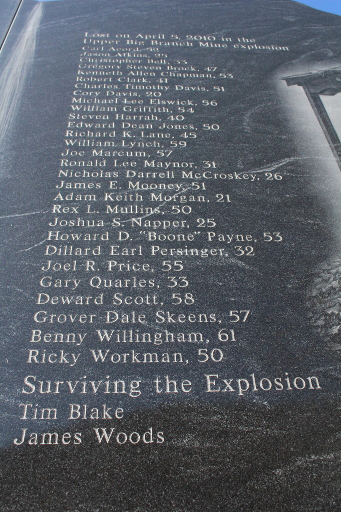 The names and ages of the miners who died in the UBB disaster are etched into the memorial.
