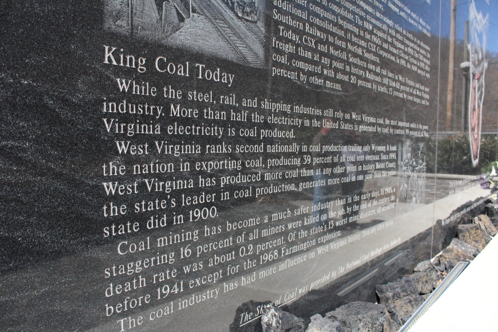 "The reflections of Paul and Patty Lavender are seen in the side of the UBB memorial, which tells the story of ""King Coal."""