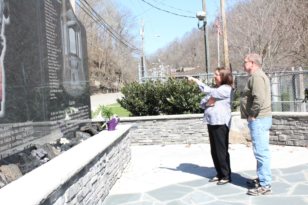Patty Lavender shows her husband, Paul, where the name of her cousin is located on the UBB memorial in Whitesville, W.Va.