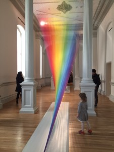 Patrons observe a rainbow installation from artist Gabriel Dawe at the Renwick Gallery in Washington, D.C.